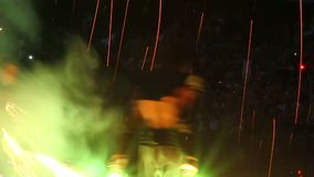 Night time lapse fire show performance with fireworks, pois, chains, sparkles stock video