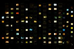 Night time lapse of Light in the windows of a multistory building. life in a big city.  stock photos