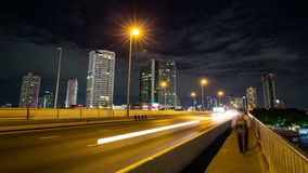 Time lapse from a roadside bridge with a train stop by, Bangkok, Thailand. Night time lapse from a roadside bridge with a train stop by, Bangkok, Thailand stock footage