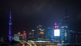 Night time lapse, Shanghai, China. SHANGHAI, CHINA - JANUARY 06, 2016: Night time lapse of the Huangpu river, the Pudong financial business district seen from stock footage