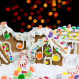 Night Time Lights behind Gingerbreadh Houses during the Holidays Stock Image