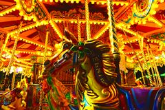 Night time merry go round horse Stock Photo