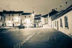 Night time in old Englsih coastal village. Royalty Free Stock Image