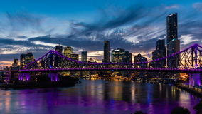 Night time panorama of Brisbane city with purple lights on Story Bridge stock video