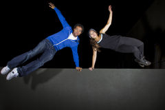 Night Time Parkour. Free runner doing parkour at night on a rooftop Stock Image