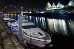 Night-time photograph of Newcastle and Gateshead Quayside, Engla. Night-time photograph of Newcastle and Gateshead Quayside in England with Yacht, Millennium Royalty Free Stock Photo