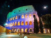A night time picture of Oval amphitheatre in the centre of the city of Rome, Italy with light and full moon stock photography