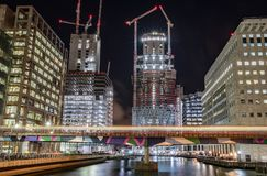 Night-time shot of construction at Canary Wharf, London, United Kingdom. Night-time shot of construction and tube in motion at Canary Wharf, London, United Stock Images