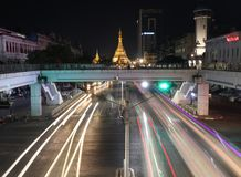 Night time and speed of light of golden octagon of Sule pagoda at Square foot overpass on the crossroad of Anawrahta Rd. and Sule royalty free stock images