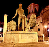 Night Time Statue of Hercules and two lions in Plaza del Socorro in Ronda, Andalucia, Spain Royalty Free Stock Images