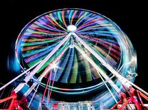 Night time striped colored ferris wheel royalty free stock image