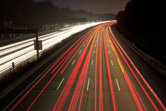 Night time traffic. On highway royalty free stock photography