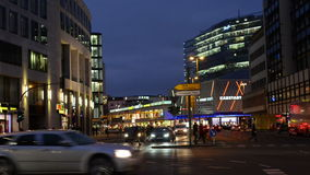 Night time traffic at Berlin district Charlottenburg next to Bahnhof Zoo stock footage