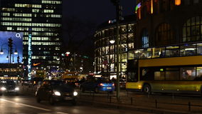 Night time traffic at Berlin district Charlottenburg next to Bahnhof Zoo stock video footage