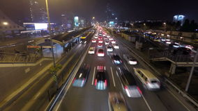 Night time traffic in a big city. Time lapse. Time lapse video of a rush hour traffic flow at night in Mecidiyekoy, Istanbul, Turkey. (With Gopro 4 on a tripod stock video