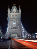 Night-time traffic crossing Tower Bridge in London. Night-time traffic crossing floodlit Tower Bridge in London Stock Photos