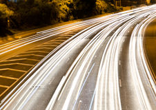 Night time traffic on a highway. Long exposure picture of busy highway with lights at night time in Toronto, Canada royalty free stock photography