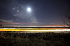 Traffic light trails at night. Night time traffic trail on highway/ motorway Stock Image