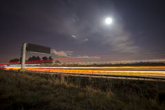Traffic light trails at night. Night time traffic trail on highway / motorway Royalty Free Stock Photography