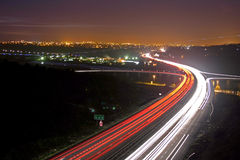 Night Time Travel. Rush hour traffic shot from above a busy road Night photo of motorway showing streaking trails of light Royalty Free Stock Image