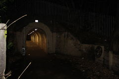 Night time Tunnel. Tunnel under Railway line  in Riversley Park Nuneaton Warwickshire. Graffiti on walls Stock Photography