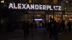 Night time video of people and passengers at Alexanderplatz Station, Berlin, Germany. PEOPLE PASSENGERS OUTSIDE ALEXANDERPLATZ TRAM AND TRAIN STATION, BERLIN stock footage