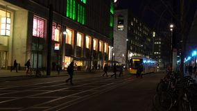 Night time video of people and trams near Alexanderplatz Station, Berlin, Germany stock footage