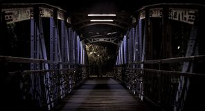 Night time on a bridge full of locks stock photos