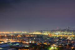 Night time view of the city and lighting from Oil refinery Stock Photo
