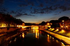 Night time view up the Tiber River, Rome, Italy. Horizontal with copy space for text stock photo