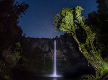 Night time water fall with stars stock photos