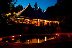 Night time wedding tent with a pool reflection Stock Image