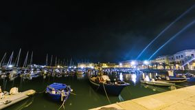 Night timelapse of blue boats floating in a peaceful harbor in Southern Italy. Night timelapse, or nightlapse, of blue fishing boats and sailboats floating in a stock video