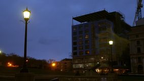 Night timelapse of building under development in urban city. 