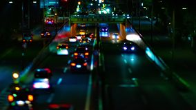 A night timelapse of the city street at the downtown in Setagaya Tokyo tilt-shift tilting. A night timelapse of the city street at the downtown tilt-shift stock video footage