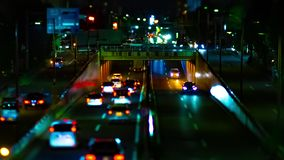 A night timelapse of the city street at the downtown in Setagaya Tokyo tiltshift panning. A night timelapse of the city street at the downtown tilt-shift panning stock video footage