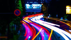 A night timelapse of the city street at the downtown in Suginami Tokyo tiltshift tilting. A night timelapse of the city street at the downtown tilt-shift tilting stock footage
