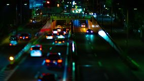 A night timelapse of the city street at the downtown in Setagaya Tokyo tilt-shift tilting. A night timelapse of the city street at the downtown tilt-shift stock video