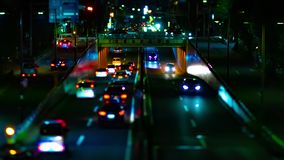 A night timelapse of the city street at the downtown in Setagaya Tokyo tiltshift zoom. A night timelapse of the city street at the downtown tilt-shift zoom stock video