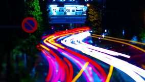 A night timelapse of the city street at the downtown in Suginami Tokyo tiltshift zoom. A night timelapse of the city street at the downtown tilt-shift zoom stock video footage