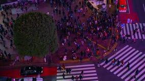 Night timelapse crossing in Shibuya Tokyo high angle middle shot tilt stock video