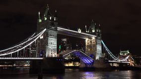 Night timelapse London Tower Bridge opens and closes, lively city, good economy, work day and night. UHD 4K stock video footage