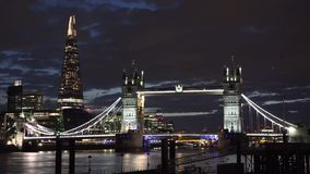 Night timelapse of London Tower Bridge and the Shard. UHD 4K stock video footage