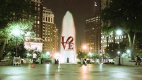 Night timelapse of LOVE sign and a fountain in Love Park of Philadelphia stock video