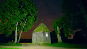 Night timelapse with a magic house and stars, crane stock video footage