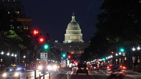 Night Timelapse View of Pennsylvania Avenue Traffic and Capitol Dome. 9002 A night time lapse view of traffic activity on Pennsylvania Avenue in Washington, D.C stock video footage