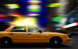 Night in Times Square. Cab rushing through colorful New York's Times Square at night royalty free stock photo
