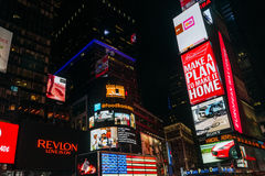 Night Times Square in New York, USA. New York, USA - September 20, 2015: Glowing neon advertising signboards in Times Square at night in New York royalty free stock photos