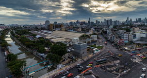 Night to day passing coud and traffic on road near Bangkok Railway Station stock video footage