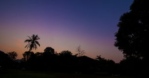 Night To Day With Sunrise Behind Mountain And Silhouette Row Of Tree. In Thailand stock video